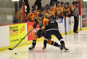 Yarmouth Mariners forward Reilly Mayne, left, tries to get past Valley Wildcats defenceman Aidan Clarke Sept. 10 during Maritime Junior Hockey League pre-season action at the Kings Mutual Century Centre in Berwick.
