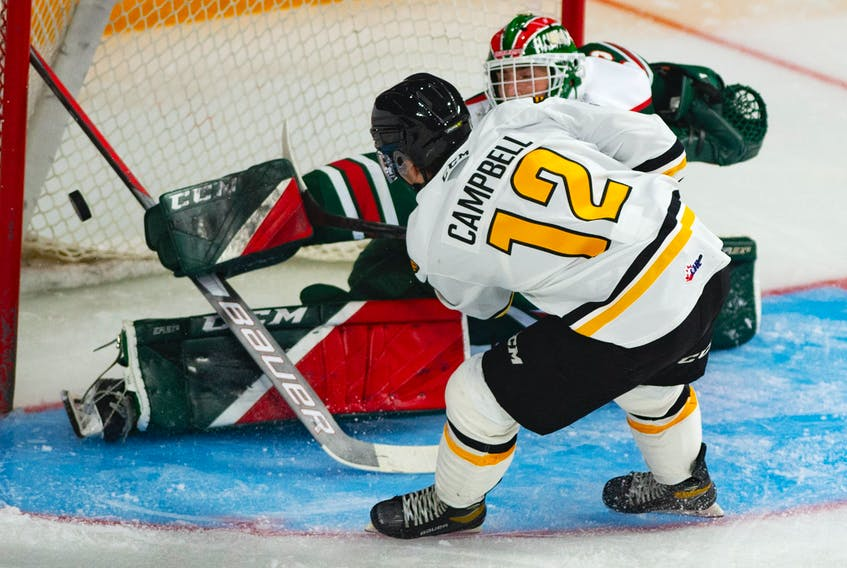 Halifax Mooseheads goalie Brady James makes a save on Cape Breton Eagles centre Jack Campbell during Saturday's QMJHL exhibition game at the Scotiabank Centre.