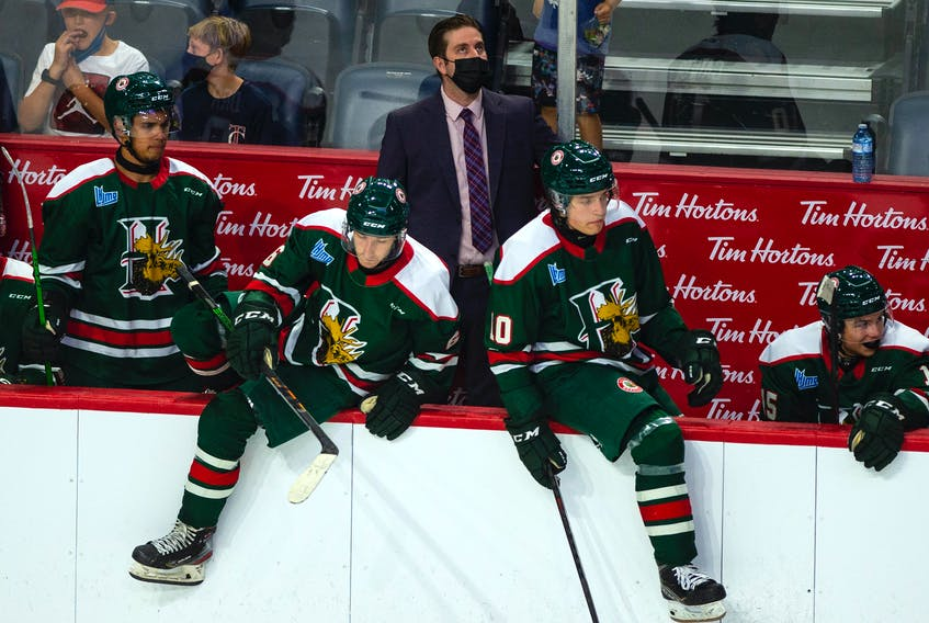 Halifax Mooseheads coach Sylvain Favreau looks at a replay on the scoreboard during an exhibition game against the Cape Breton Eagles on Saturday, Sept. 11, 2021.