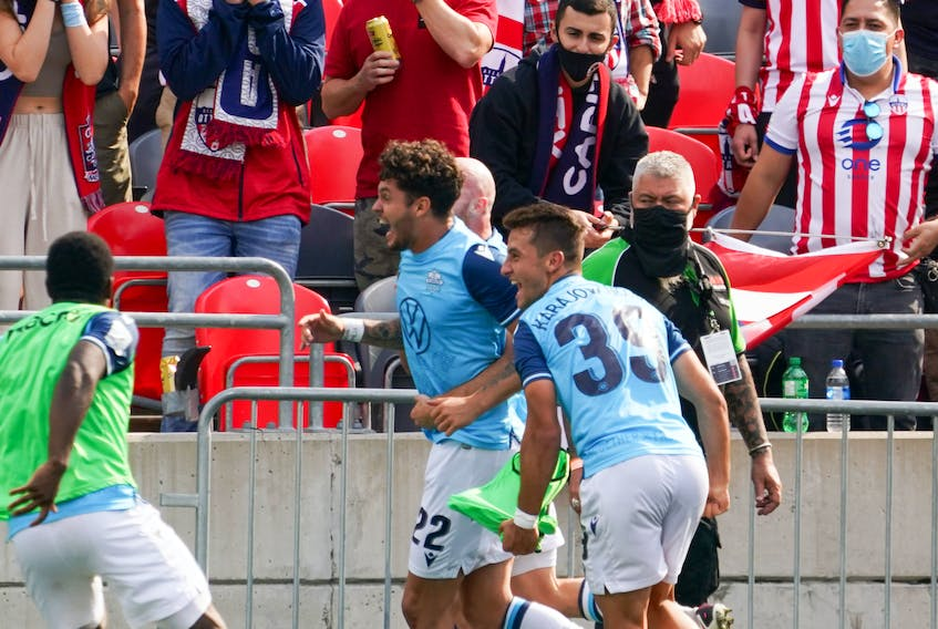 HFX Wanderers FC striker Joao Morelli (22) celebrates his game-winning goal in the 89th minute of the Canadian Premier League team's 2-1 victory over Atletico Ottawa in Ottawa on Saturday.