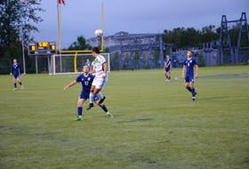 Nathan Chow of the UPEI Panthers jumps in the air to head the ball while closely guarded by the St. Francis Xavier X-Men's Logan Harrington, 17, during the first half of an Atlantic University Sport men's soccer match at UPEI on Sept. 10. The X-Men defeated the Panthers 2-1.