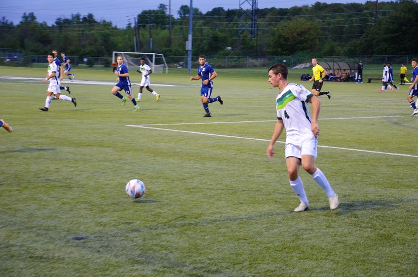 The UPEI Panthers' Colin Curran, 4, controls the ball during an Atlantic University Sport men's soccer game versus the St. Francis Xavier X-Men at UPEI on Sept. 12. The X-Men defeated the Panthers 2-1 in the opening match of the 2021 regular season for both teams. - Jason Simmonds