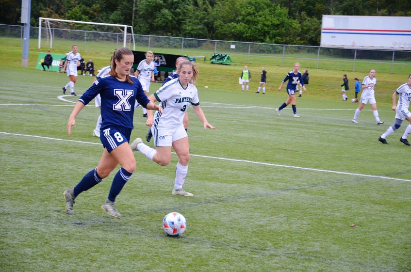 Amanda Smith, 8, of the St. Francis X-Women, controls the ball while the UPEI Panthers' Roselyn Kushko defends during an Atlantic University Sport women's soccer game at UPEI on Sept. 10. Smith scored both goals for the X-Women in a 2-1 win. - Jason Simmonds