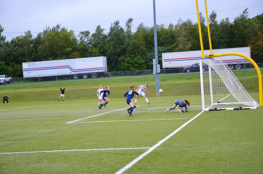 Braylan MacEachern heads the ball into the net to lift the UPEI Panthers into a 1-1 against the St. Francis Xavier X-Women on Sept. 10. X-Women keeper Christina Gentile and teammates Abby Steen, 10, and Megan Frost, 2, hustle to get back in the play. The X-Women scored a late goal to defeat the Panthers 2-1 in the season-opening game for both teams in Atlantic University Sport play. - Jason Simmonds