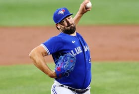 Blue Jays starting pitcher Robbie Ray throws to an Orioles batter in the first inning at Oriole Park at Camden Yards in Baltimore, Friday, Sept. 10, 2021.