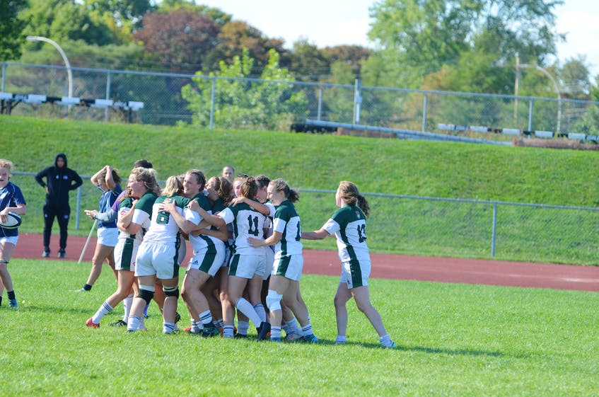 The UPEI women's rugby team celebrates a 38-31 win over the St. Francis Xavier X-Women in the opening game of the 2021 season for both teams on Sept. 11. It marked the X-Women's first regular-season loss in Atlantic University Sport regular-season play since 2013. - Jason Simmonds
