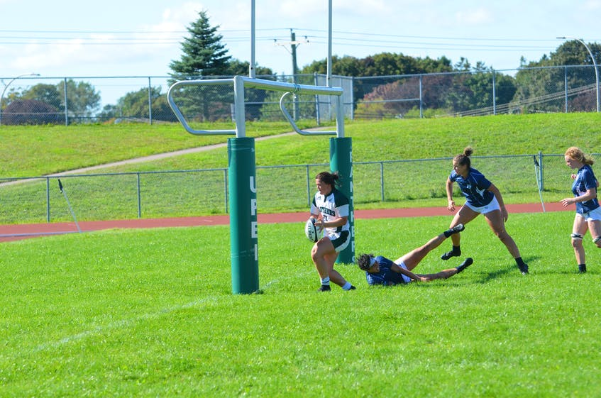 Brinten Comeau races to score a second-half try for the UPEI Panthers in an Atlantic University Sport women's rugby game against the St. Francis Xavier X-Women at UPEI on Sept. 11. The Panthers won the game 38-31. - Jason Simmonds