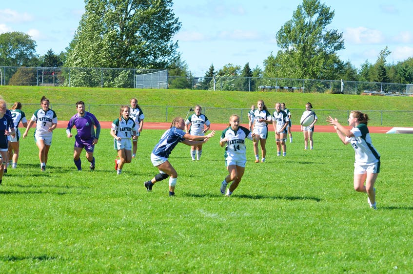 The UPEI Panthers' Maddy Clements, 14, passes the ball to teammate Annika Wadlegger, 13, during the second half of an Atlantic University Sport women's rugby contest versus the St. Francis Xavier X-Women at UPEI on Sept. 11. UPEI won the season-opening contest 38-31. - Jason Simmonds