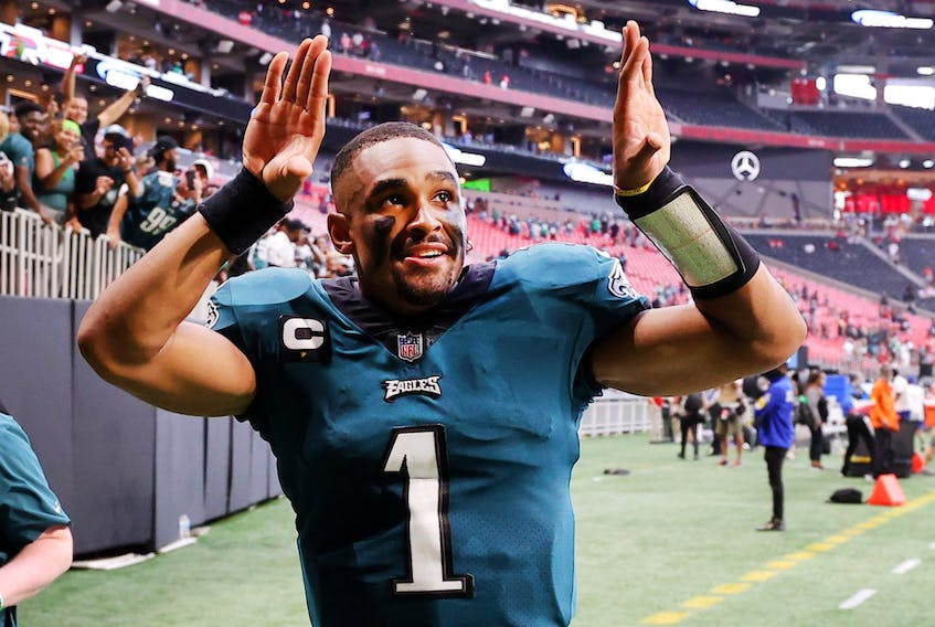 Jalen Hurts of the Philadelphia Eagles celebrates after the game against the Atlanta Falcons at Mercedes-Benz Stadium on September 12, 2021 in Atlanta, Georgia. (Photo by Kevin C. Cox/Getty Images)