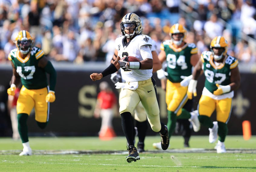 Jameis Winston of the New Orleans Saints carries the ball against the Green Bay Packers during the first quarter at TIAA Bank Field on September 12, 2021 in Jacksonville, Florida. (Photo by Sam Greenwood/Getty Images)
