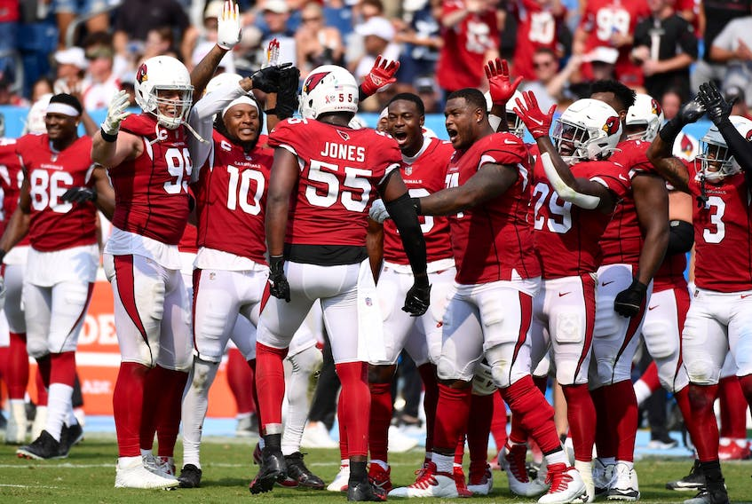 Arizona Cardinals defensive end Chandler Jones (55) celebrates with teammates after a sack on fourth down during the second half against the Tennessee Titans at Nissan Stadium. Mandatory Credit: Christopher Hanewinckel-USA TODAY Sports