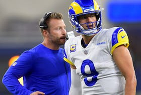 Rams head coach Sean McVay talks with quarterback Matthew Stafford (9) during a time out in the fourth quarter of the game against the Chicago Bears at SoFi Stadium.