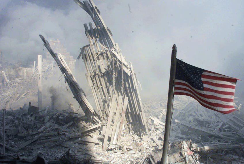 An American flag flies near the base of the destroyed World Trade Center in New York, on September 11, 2001.