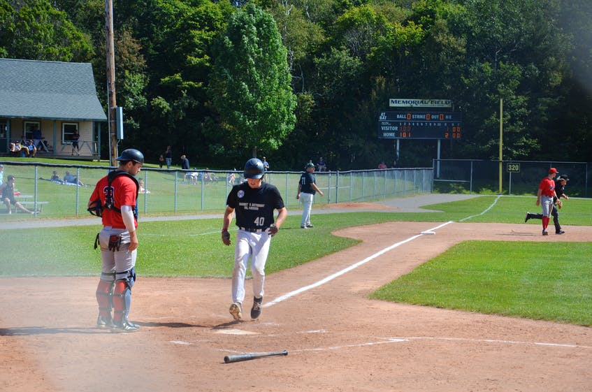 Charlottetown Gaudet's Auto Body Islanders shortstop Logan MacDougall scores a run against the Saint John Alpines in Game 2 of the New Brunswick Senior Baseball League semifinal series at Memorial Field in Charlottetown on Aug. 29. MacDougall played a big role in the Islanders' 2-1 road win over the Moncton Fisher Cats in the opening game of the best-of-seven final series on Sept. 12. - Jason Simmonds