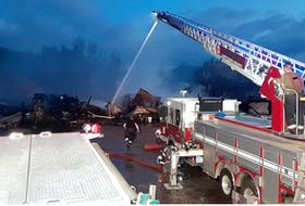 Volunteer firefighters spent about six hours knocking down an early Saturday morning fire at the Northside Auto Salvage on Tobin Road in North Sydney. CONTRIBUTED • NORTH SYDNEY FIRE AND RESCUE