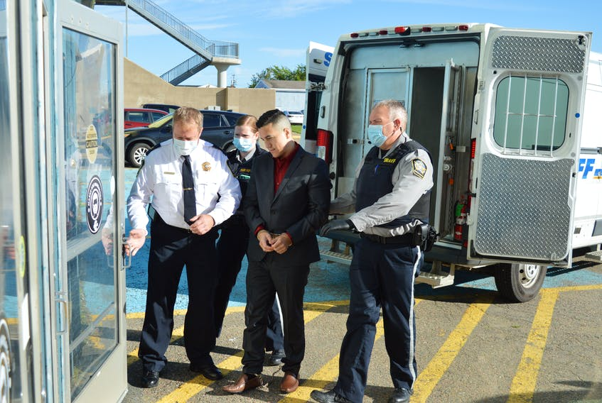 The Supreme Court trial for Kirk Daniel Gould, 31, of Eskasoni, is to begin today in Sydney. Gould is charged with second-degree murder in connection with the 2019 death of Harry James Lafford Jr., 33, also of Eskasoni. Gould is shown here being escorted by sheriff deputies into Sydney's Centre 200 on Monday where jury selection was being held. CAPE BRETON POST PHOTO