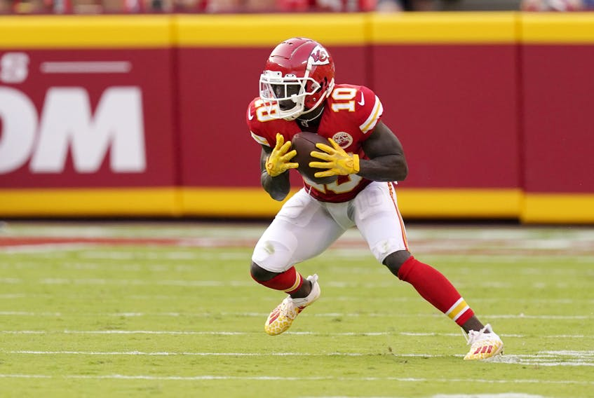 Kansas City Chiefs wide receiver Tyreek Hill reverses his field en route to a 75-yard touchdown pass during the second half of an NFL football game against the Cleveland Browns Sunday, Sept. 12, 2021, in Kansas City, Mo.