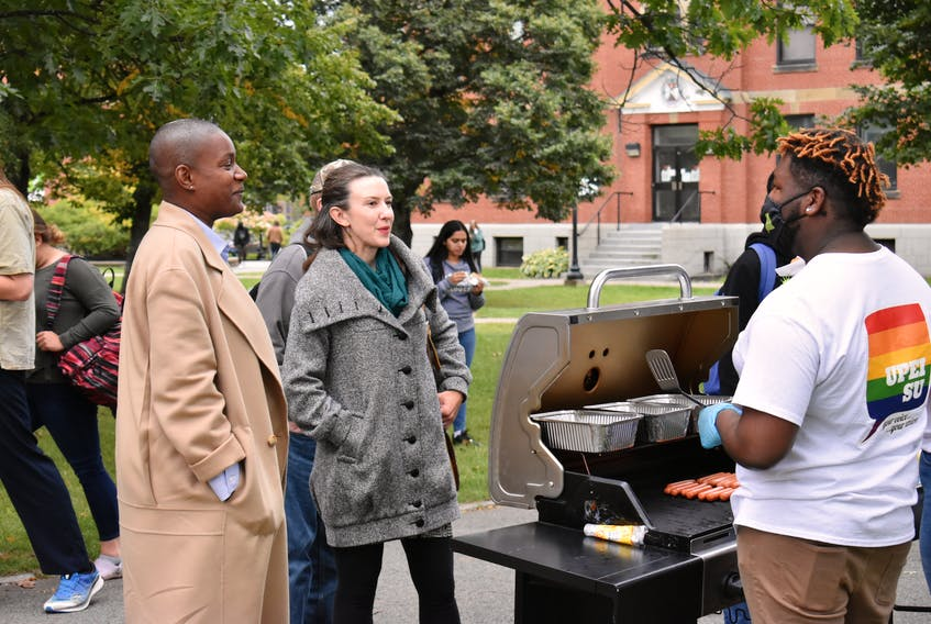 Green Party of Canada leader Annamie Paul, left, and Malpeque Green candidate Anna Keenan talk with Nathan Lacroix, a UPEI Student Union member, as part of a UPEISU event on Sept. 13. Paul kicked off a campaign tour of Prince Edward Island by stopping at the event to engage with young voters and spoke with Lacroix about their shared Caribbean connections.