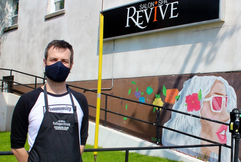 Mike MacDonald, master stylists and owner of Revive Hair Studio and Spa, stands outside his Sydney business on June 1, 2020, the first day back to work after the first provincewide closure of closed non-essential businesses as part of the COVID-19 pandemic response to stop spread. NICOLE SULLIVAN/CAPE BRETON POST