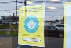 A mandatory mask notice in the window of the Medicine Shoppe Pharmacy on Welton Street in Sydney. Owner Hugh Toner says as of Wednesday the public will not have to wear a mask in his pharmacies but the staff will be wearing them. Sharon Montgomery-Dupe/Cape Breton Post