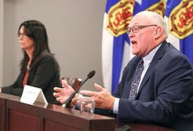 Dr. Robert Strang, chief medical officer of health for Nova Scotia, speaks at a news briefing Tuesday, Sept. 14, 2021, with Health Minister Michelle Thompson. They announced that the phase 5 reopening plan that would have lifted mandatory mask and gathering restrictions would be pushed back until Oct. 4.
