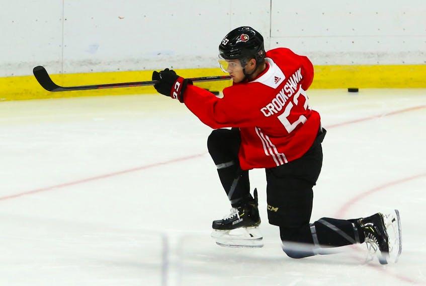 Angus Crookshank shoots on Zach Papytsakis of the Ottawa Senators at the Canadian Tire Centre in Ottawa on Monday.