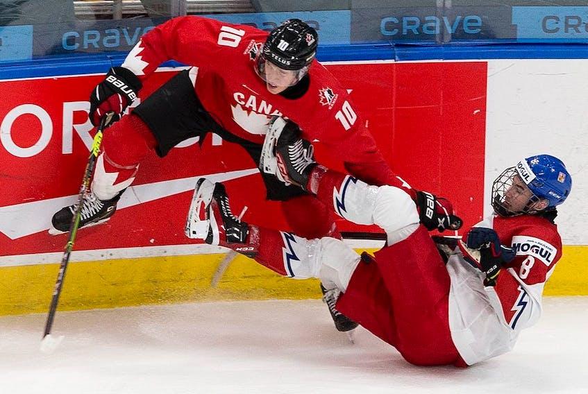 Canada's Dylan Holloway (10) upends Czech Republic's David Jiricek (8) in their IIHF world junior championship quarter-final Saturday, Jan. 2, 2021 in Edmonton.