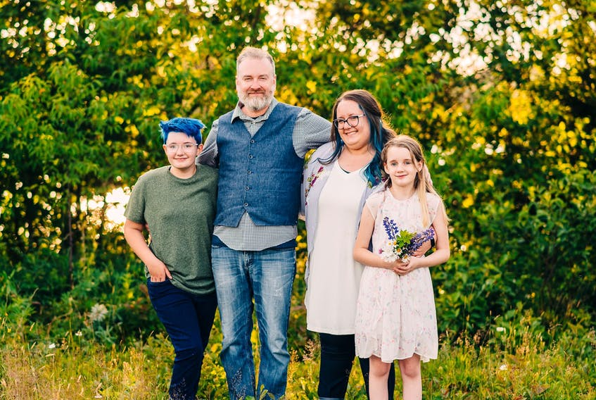 Evelyn Collins, far left, and her sister Amelia Collins, far right, asked their parents, Jonathan and Adrienne Collins, if they could keep wearing masks to school when Phase 5 kicks in and they are no longer mandatory. CONTRIBUTED