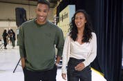 """Leylah Annie Fernandez makes a joke about """"having to make herself taller"""" as she walks beside Félix Auger-Aliassime at a news conference in Dorval on Tuesday, September 14, 2021, a few days after their participation in the U.S. Open Tennis tournament."""