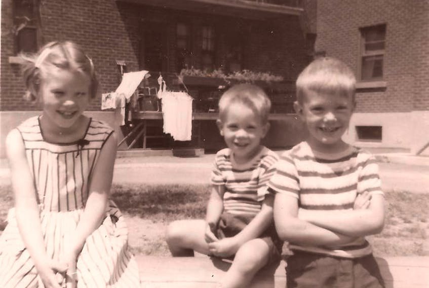 Snapshots from 1955, at Benny Farm in N.D.G.: Top, Andrew Caddell on skates for the first time outside the housing complex; and in the block yard, beside siblings Susan and Ian, left, with the family's second-floor apartment behind them. Photo courtesy Caddell family.