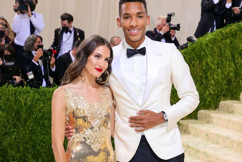 Félix Auger-Aliassime and guest attend The 2021 Met Gala Celebrating In America: A Lexicon Of Fashion at Metropolitan Museum of Art on September 13, 2021, in New York City.