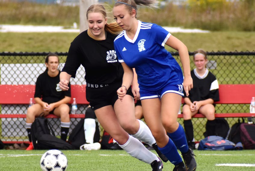 Ava Marks of the Sydney Academy Wildcats, right, works her way around Morgan O'Keefe of the Glace Bay Panthers during Cape Breton High School Soccer League girls' action at Open Hearth Park Turf in Sydney, Tuesday. The teams tied 1-1. JEREMY FRASER/CAPE BRETON POST