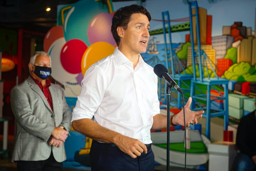 Liberal leader Justin Trudeau answers questions from reporters at the Discovery Centre during a campaign stop in Halifax on Wednesday, Sept 15, 2021.