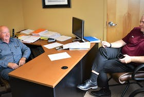Stu Rath and Dave Higgins recently going over school arrangements for players already signed for the Truro Jr. A Bearcats 2021-22 team.