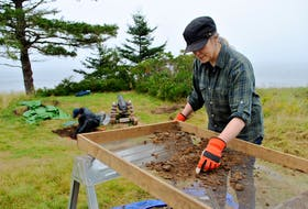 Vanessa Smith (foreground), assistant curator of archaeology at the Nova Scotia Museum, sifts dirt through a screen while Amber Laurie, assistant curator of Marine History at the Maritime Museum of the Atlantic, works in one of the excavation pits at the Fort St. Louis National Historic Site in Port LaTour, where a fourth archaeological dig is underway for the month of September. KATHY JOHNSON