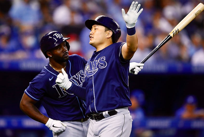 Ji-Man Choi of the Tampa Bay Rays celebrates with Randy Arozarena after hitting a solo home run against the Toronto Blue Jays at Rogers Centre on September 14, 2021 in Toronto.