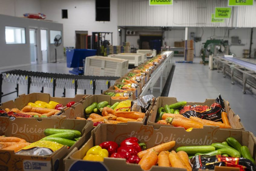 Fresh vegetables are packed into boxes and ready for shipment inside the newly unveiled Leamington Regional Food Hub, on Thursday, August 12, 2021.