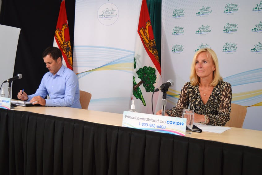 Norbert Carpenter, left, director of the Public Schools Branch, and Dr. Heather Morrison, P.E.I.'s chief public health officer, take part in a COVID-19 briefing on Sept. 15.