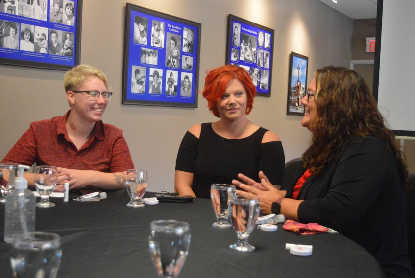 Carpentry student Megan MacAulay, left, and architectural sheet metal student Tera Cormier, centre, chat with Maggie Budden, Cape Breton project co-ordinator with the Office to Advance Women Apprentices, during a networking luncheon Tuesday at the Joan Harriss Cruise Pavilion in Sydney. Budden, who was Canada's first female Red Seal ironworker, has been running the organization's Sydney office since it opened earlier this summer. However, this week may just be Budden's busiest thus far as she has also hosted, in conjunction with the Cape Breton Building and Construction Trades Council, a networking breakfast for area contractors. And, on Wednesday evening, Budden hosted a pizza networking session for tradeswomen or women interested in a trades career. DAVID JALA • CAPE BRETON POST
