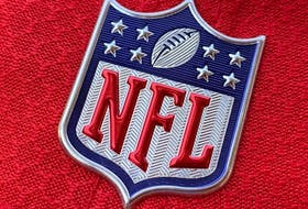 In this file photo the official NFL logo is seen on the back of a hat in Los Angeles on July 21, 2020.