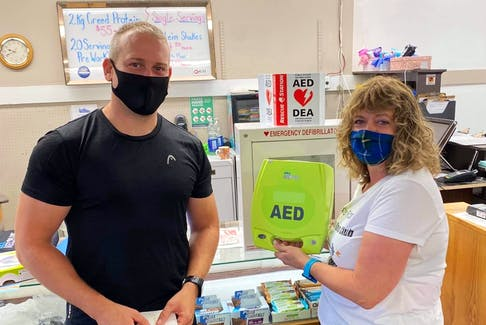 Advanced care paramedic Joel Connolly fundraised for an AED for the Locker Room Health and Fitness Club in Windsor. He presented the $1,650 device to owner Janice Forand on Sept. 1.