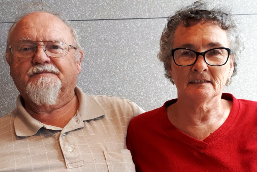 Wayne and Debbie Mailman who were in Florida last year and contracted COVID-19, are facing steep medical bills for their time in hospital in the U.S. Here they are seated at the at the McDonald's restaurant in New Minas.
