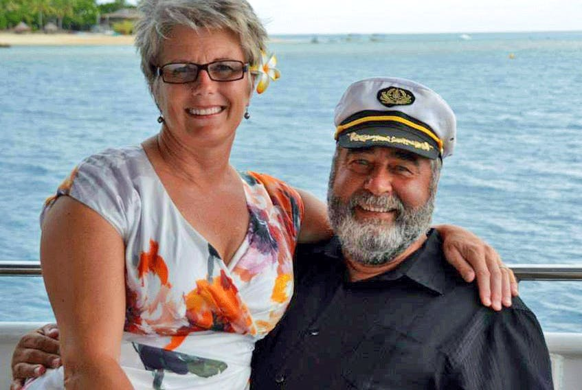 Peter and Sharon White-Robinson aboard Kahu, their former luxury yacht which was raided by British police.