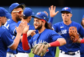 Blue Jays shortstop Bo Bichette celebrates with teammates after defeating the Tampa Bay Rays at the Rogers Centre on Wednesday, Sept. 15, 2021.