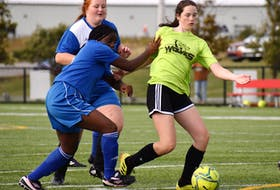 Katie Pastruck of the Breton Education Centre Bears, right, works her way by Lemuela Ajuwon of the Sydney Academy Wildcats during Cape Breton High School Soccer League girls' junior varsity action at Open Hearth Park in Sydney, Wednesday. BEC and Sydney Academy battled to a scoreless draw. JEREMY FRASER/CAPE BRETON POST.