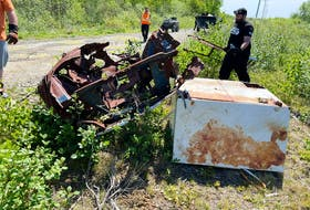 The Cape Breton Environmental Association works with Price is Right Moving and Trucking to remove some heavy items at an illegal dumpsite. Photo by the Cape Breton Environmental Association