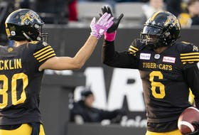 Hamilton Tiger Cats quarterback David Watford (6) celebrates his touchdown with teammate wide receiver Jaelon Acklin (80) during second half CFL football game action against the Ottawa Redblacks, in Hamilton, Ont., Saturday, Oct. 19, 2019. The Tiger-Cats re-signed American quarterback Watford on Wednesday.