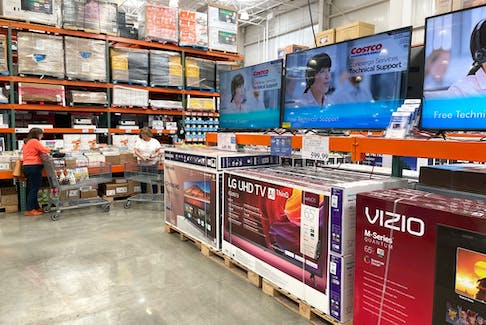 Televisions are displayed at a Costco store on July 13, 2021.