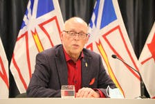 Newfoundland and Labrador Minister of Health and Community John Haggie speaks to members of the media Thursday about ambulance services in the province.