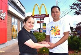Anapol (Apple) Camodoc, left, manager of the Welton Street and Walmart McDonald's restaurants in Sydney, and her husband Denies Camodoc, manager of the Glace Bay McDonald's, at the Welton Street location, Tuesday. The couple first met nine years ago through their jobs at McDonald's and they ended up tying the knot on Sept. 7. Sharon Montgomery-Dupe/Cape Breton Post